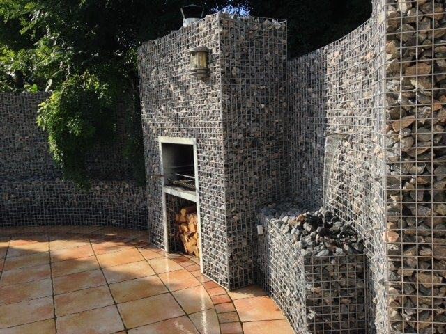 Round gabions with BBQ and waterfall